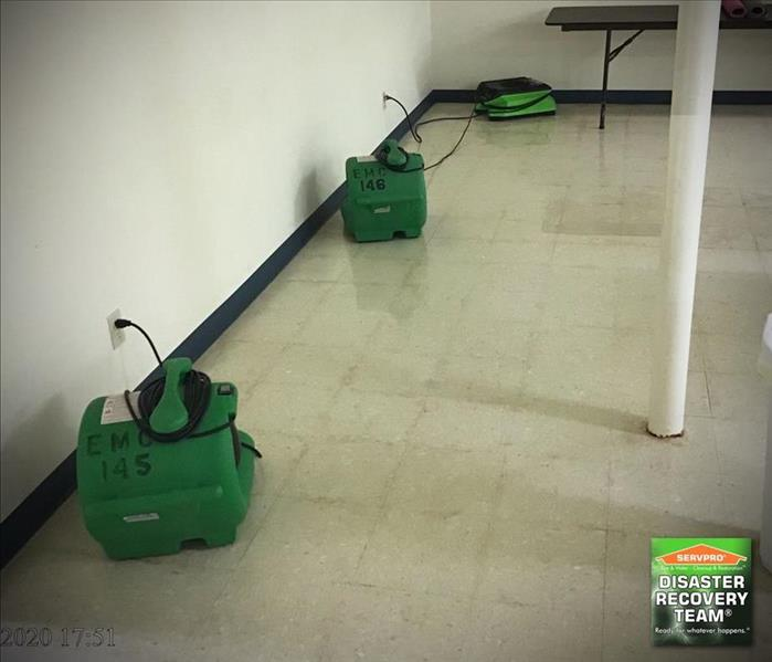 commercial basement floors cleaned and sanitized with air movers in place
