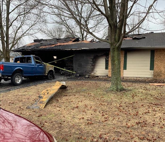 a ranch style home that was damaged by fire.