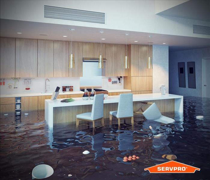 a flooded kitchen with debris floating in the water